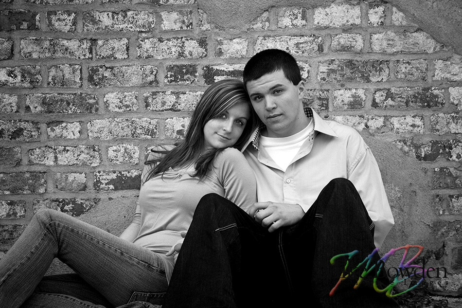 Young_couple_next_to_wall_BW
